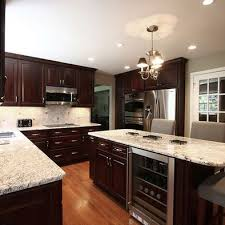 what color granite goes with brown cabinets kitchen design pictures remodel decor and ideas