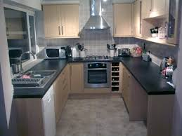 cream kitchen cabinets with black countertops u2013 home design and