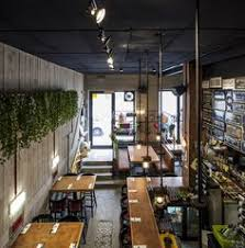 Sculptural Wood Elements Flow From The Exterior To The Interior Of - Interior restaurant design ideas