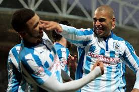 Huddersfield Town frontmen Nahki Wells and James Vaughan backed to     Huddersfield Examiner Nahki Wells celebrates his goal with James Vaughan
