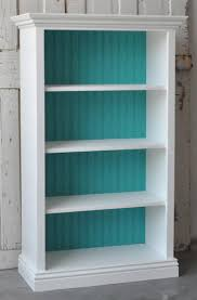 bookcase in distressed white and teal living space pinterest