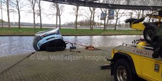 porsche dealership porsche falls into canal in amsterdam business insider
