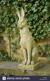 garden ornament of a hare jackrabbit or rabbit stock photo