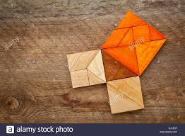 pythagorean theorem illustrated with wooden pieces of tangram a