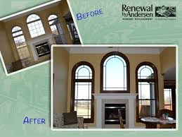 white windows with stained trim before white interior arch top