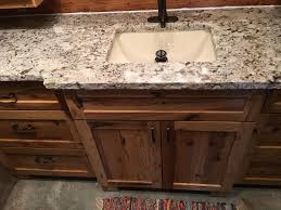 alaskan white granite with chiseled edge burnished bronze faucet