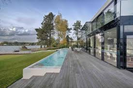home facade glass overlooking lake pool 1 back playuna