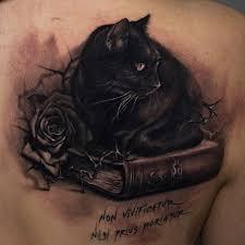 cat sitting on moon tatto