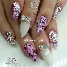 luminous nails pretty in pink acrylic nails with encased flowers