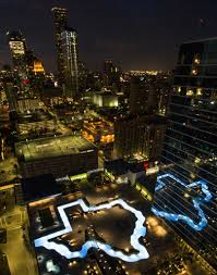 Zoo Lights In Houston by Marriott Marquis Houston Debuts Texas Shaped Pool In Grand Opening