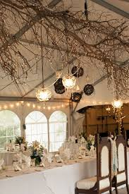 branch decor rustic indoor wedding decoration with tree braches and lights