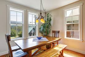 breakfast table for two close up of wooden dining table with two chairs and bench stock