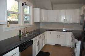 Distressed White Kitchen Cabinets by Long White Wooden Floating Cabinet Plus Black Counter Top Placed