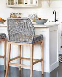 these woven counter stools are such a fun unexpected kitchen