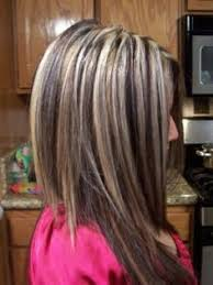 brunette hairstyle with lots of hilights for over 50 white hair and brown hair with highlights yet another view of