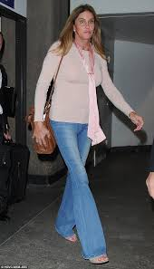jenner sweater caitlyn jenner rocks denim flares and pink sweater as she arrives