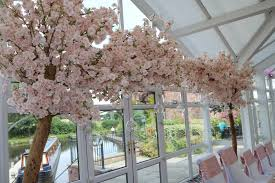 blossom trees arches uplit event hire