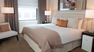 Bedroom Bed In Corner Luxury Hotel Suites In Nyc One Bedroom Suite The Benjamin