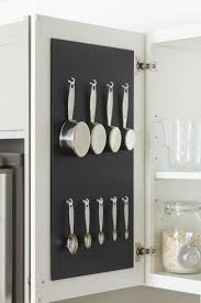 kitchen organization ideas for the inside of the cabinet organize and save space in the kitchen by hanging measuring cups and