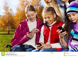 South African teen culture   Group of young adults using mobile phone     Stock Photo Shutterstock