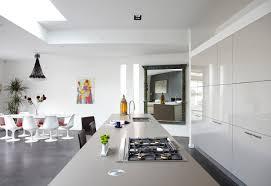 beautiful white kitchen design with views of the open sea irosi