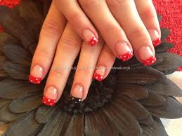 acrylic nails with red and black polka dot nail art them bad
