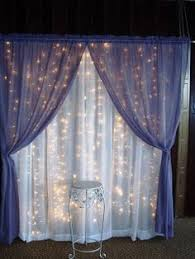 wedding backdrop stand curtain lights and sheer fabric would make a neat backdrop for a