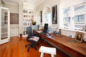extra long desk table long desk built in beneath window office design pinterest