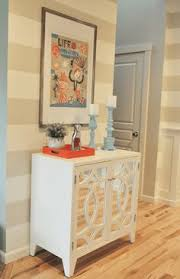 the wall color is a flat paint sherwin williams sw 7010 white