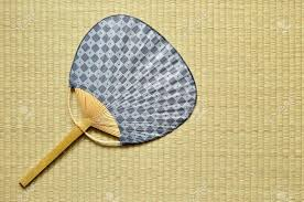 uchiwa fan japanese fan uchiwa on tatami stock photo picture and royalty