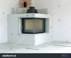 modern corner woodfired fireplace under construction stock photo