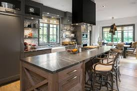 long kitchen island with cooktop and hood contemporary kitchen