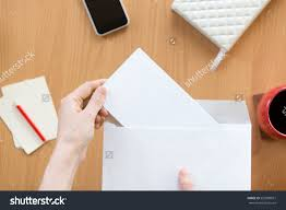 female hands holding envelope blank paper stock photo 520989877