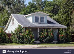 pale blue 2 story clapboard bungalow with dormer windows white