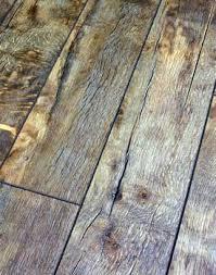 hardwood floors versus laminate floors compare facts