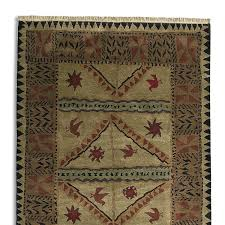 kilimanjaro knotted rug inspired by african art motifs our