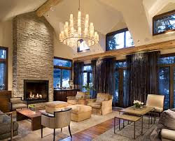 living room wall with stone high fireplace and high glass