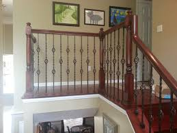 Wood Banisters And Railings Updated Wood Balusters To Wrought Iron Balusters Traditional