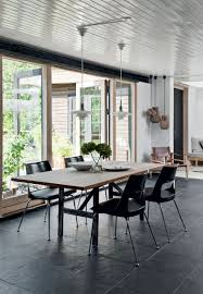 black slate flooring under a dining set of a light plank table and