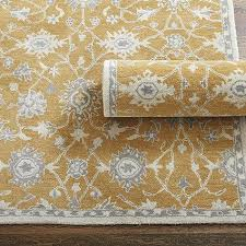 hand tufted rug in yellow and grey