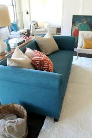 Teal Chesterfield Sofa Peacock Teal Chesterfield Sofa With Orange And Teal Color Scheme