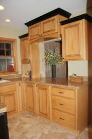 kitchen crown molding ideas kitchen ideas with hickory cabinets notice the crown molding at