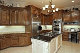 white wooden kitchen island with cooktop glossy black island top