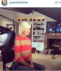 yolanda fosters hair yolanda foster s red orange lace inset sweater big blonde hair