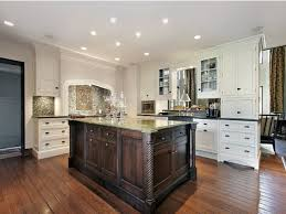 Kitchen With Cream Cabinets by White Kitchen Cabinets Quartz Countertops Dark Brown Laminated