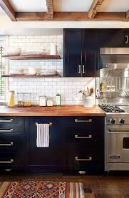 cote de texas 2017 trends in interior design upper cabinets white with white countertops this lessens a too dark look another item that has gained strength are these spot lights in kitchen