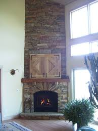 extra high ceiling corner stacked stone fireplace