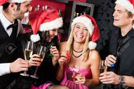 christmas party cheerful friends at having drink and fun stock