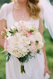 hydrangea bouquet bouquet with hydrangeas roses and peonies brides