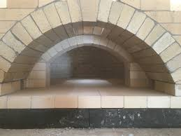 true brick ovens the face will be covered with stone arch and